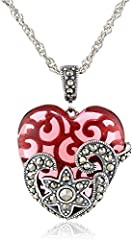 "This luxurious Morgan & Paige piece is a great addition to any accessories collection. This Sterling Silver Oxidized Genuine Marcasite and Red Garnet Colored Glass Filigree Heart Pendant 18"" necklace is sleek and classy and is sure to be ..."