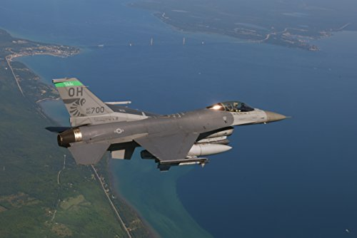 us-air-force-capt-roy-poor-an-f-16-fighting-falcon-pilot-flies-over-the-mackinac-bridge-and-mac