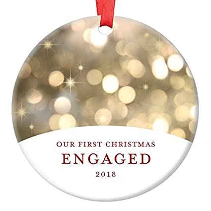 our first christmas engaged engagement ornament 2018 fiance fiance couple present idea classy champagne bokeh lights