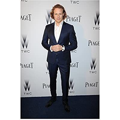 Sam Heughan Hands Clasped Looking Dapper Standing 8 x 10 inch Photo