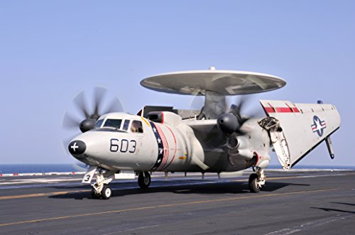 An E-2C Hawkeye, of the Bear Aces of Carrier Airborne Early Warning Squadron (VAW) 124, moves - Mfnw
