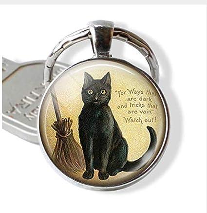 Llavero con cita de gato negro para los amantes de los gatos con escoba de cristal