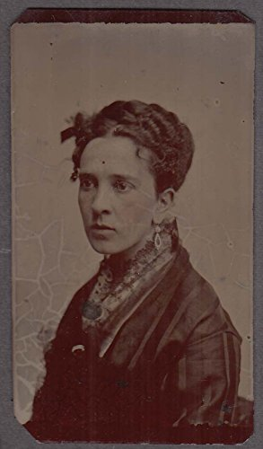 (Curly-haired woman teardrop earring lace collar studio tintype 1860s)
