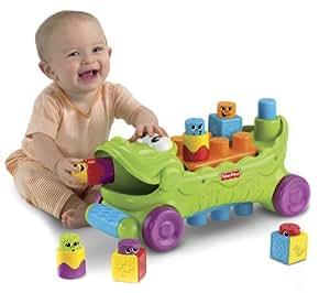 Mattel T4336 Fisher-Price - Cocodrilo musical con ruedas y piezas de apilar