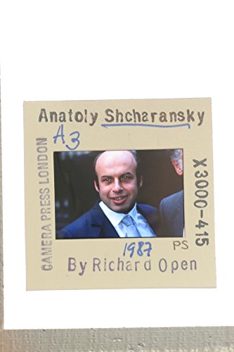 Slides photo of Natan Sharansky39;s smiling portrait.