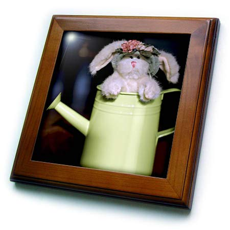 3dRose Stamp City - Holiday - Photograph of a Lovely Stuffed Rabbit Popping Out of a Watering can. - 8x8 Framed Tile (ft_308399_1)