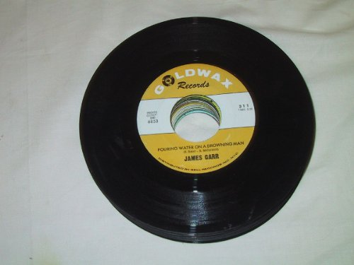 pouring water on a drowning man 45 rpm single