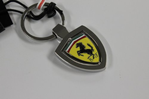 Authentic Ferrari Key Chain with Revolving Yellow Ferrari Shield Design 270000286