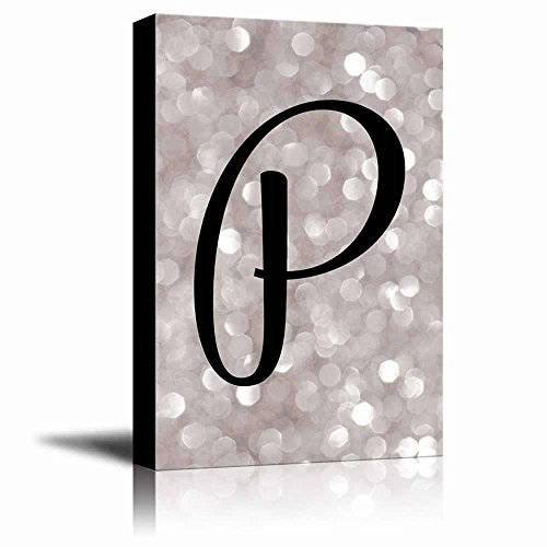 The letter P in brush stroke cursive on a champagne colored bokeh background Romantic Elegant Decor