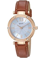 GUESS Womens U0838L2 Dressy Rose Gold-Tone Watch with Blue Dial , Crystal-Accented Bezel and Genuine Leather...