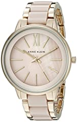 Watch Sizing Guide For a clean and polished look just add this stunning timepiece by Anne Klein™! Stainless steel case back. Gold-tone bracelet with ceramic blush-tone inlays. Jewelry clasp closure with extender. Round face. Three-hand analog...