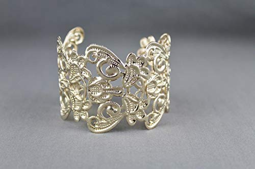 Shiny gold tone metal cuff bracelet 1 7/8 wide cut out scroll filigree pattern