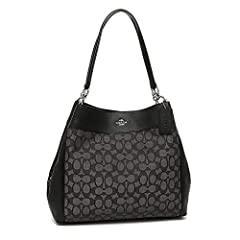 The Coach Lexy is a beautifully styled shoulder bag in signature jacquard with smooth leather trim. Silvertone hardware adorns this bag. The interior offers a center zip compartment, with inside zip pocket, cell phone and multifunction pocket...