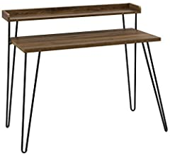 Mix industrial and modern styles together to get the Ameriwood Home haven retro desk with riser. This desk is perfect for tight spaces with its small foot print and offers 2 levels of desk space with the added riser. The medium brown woodgrai...