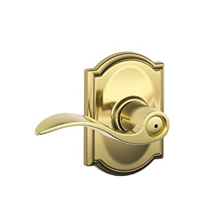 Schlage Accent Lever with Camelot Trim Bed and Bath Lock in Bright Brass
