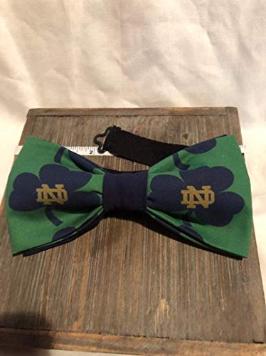 (Notre Dame themed adult pre-tied cotton bow tie. Fighting Irish fan gear. Adjustable black cotton twill 18