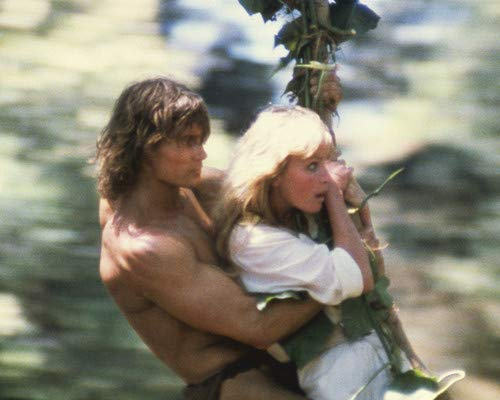 Swinging Vine - Bo Derek and Miles O'Keefe in Tarzan the Ape Man swinging on vine 11x14 HD Aluminum Wall Art