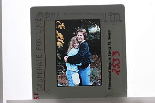 (Slides photo of Christian Slater and Tammy Lauren in the film