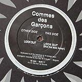 Commes Des Garcons / Lock out