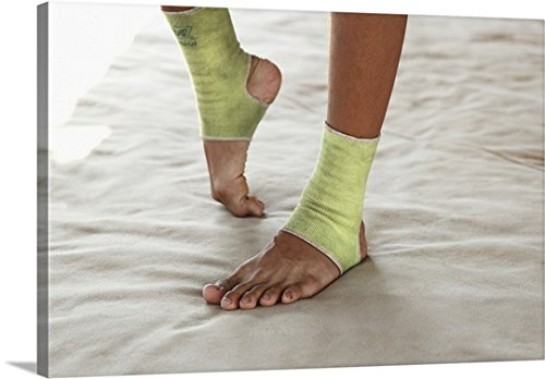 Great BIG Canvas Gallery-Wrapped Canvas entitled Muay Thai boxer streching feet before combat by greatBIGcanvas