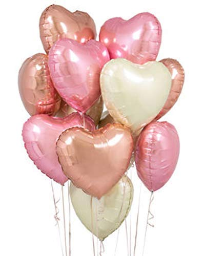Heart shaped balloons in rose gold, blush pink, and white.