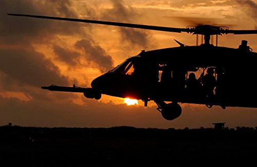 Posterazzi Poster Print Collection an HH-60G Pave Hawk Helicopter Prepares to Land Stocktrek Images, (17 x 11), Multicolored
