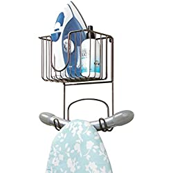 mDesign Laundry Room Wall Mount Ironing Board Holder with Small Basket - Bronze