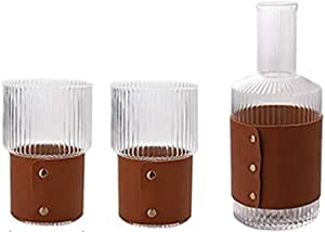 a set of a glss jug and 2 cups with sleeves
