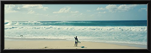 Art.com Surfer Standing on the Beach, North Shore, Oahu, Hawaii, USA by Panoramic Images Framed Photographic Print, 14 x 38'', Blue by Art, Inc.