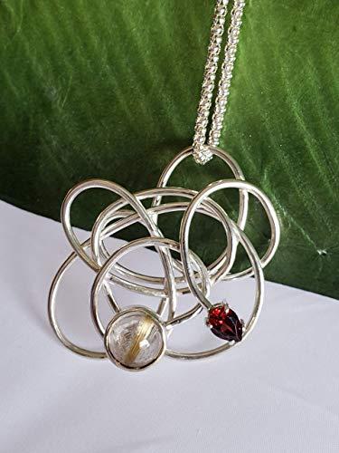 (Swirl Pendant with Brazilian Rutilated Quartz and Red Garnet )