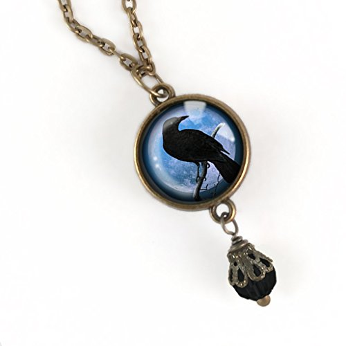 Raven or Crow silhouette over purple moon pendant necklace