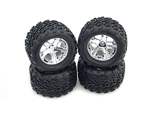 TRAXXAS 1/10 STAMPEDE 2WD SET OF (4) TIRES AND WHEELS.TRAXXAS 2.8