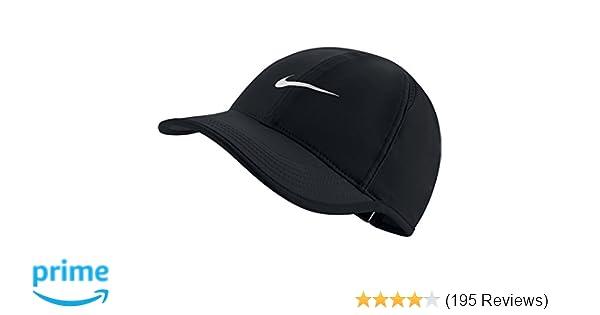 Amazon.com  NIKE Women s AeroBill Featherlight Tennis Cap 5bc498c94054