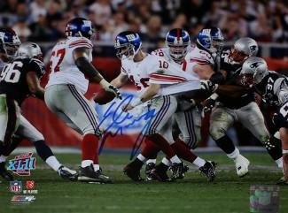Signed Eli Manning Picture - Super Bowl XLII 8x10 Escape blue sig white jersey)- Steiner Hologram - Autographed NFL Photos