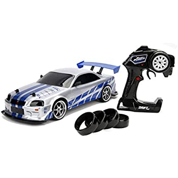 jada 99701 toys fast & furious brian's nissan skyline gt-r (bn34) drift  power slide rc radio remote control toy race car with extra tires, 1:10  scale,