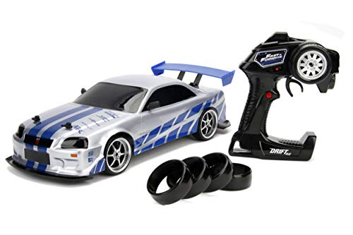 Jada 99701 Toys Fast & Furious Brian's Nissan Skyline GT-R (BN34) Drift Power Slide RC Radio Remote Control Toy Race Car with Extra Tires, 1:10 Scale, Silver/Blue