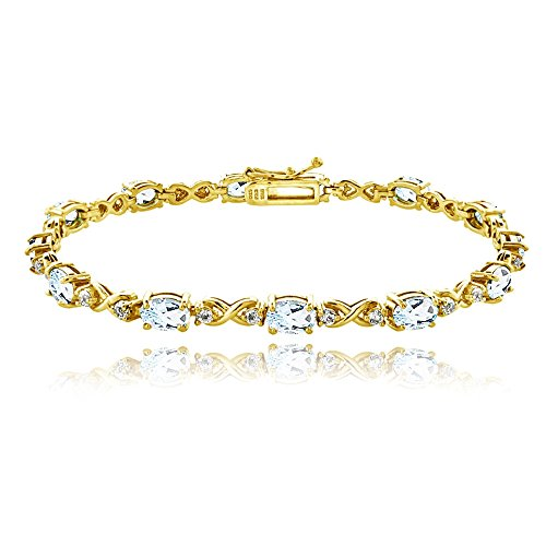 - GemStar USA Yellow Gold Flashed Sterling Silver Blue Topaz 6x4mm Oval Infinity Bracelet with White Topaz Accents