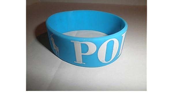 Polo pulsera de silicona azul w color blanco Polo Logo: Amazon.es ...