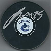 Autographed Jacob Markstrom Vancouver Canucks Hockey Puck photo
