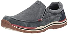 Expect the unexpected and detect the undetected with the Expected - Avillo casual slip-on sneaker from SKECHERS®. Slip-on design with SKECHERS Relaxed Fit® has a generous silhouette that accommodates your feet for a custom fit. Sturdy, canva...