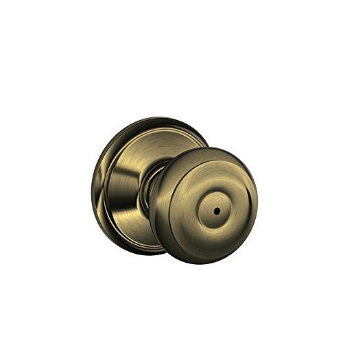 - Schlage F40VGEO609 Georgian Privacy Knob, Antique Brass