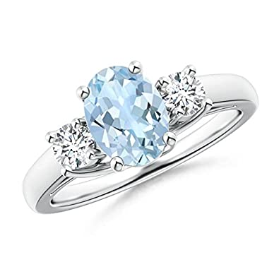 Angara Oval Aquamarine and Round Diamond Three Stone Ring