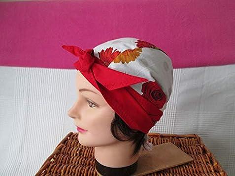 bandeau pirate au f/éminin orange avec des grosses fleurs blanches turban chimio Foulard