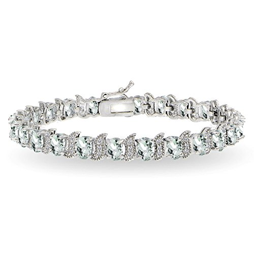 (GemStar USA Sterling Silver Aquamarine 6x4mm Oval and S Tennis Bracelet with White Topaz Accents)