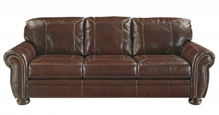 Ashley Banner Collection 5040438 Sofa with Leather Upholstery Rolled Arms Stitched Detailing Removable Seat Cushions and Traditional Style in