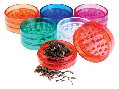 two plastic grinder herb