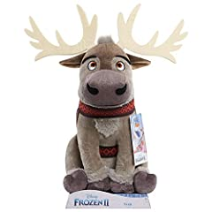 """Bring home the excitement of Disney Frozen 2 with the large plush Sven. Sven is made of Super soft fabrics, and is wearing his printed harness as seen in Disney Frozen 2. Sven sits approximately 12"""" tall, making him a great size to snuggle! C..."""