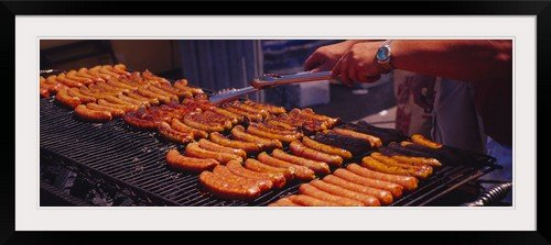 "greatBIGcanvas Close-up of a mans hand cooking hot dogs on a barbecue grill, Taste of Chicago, Chicago, Illinois Photographic Print with Black Frame, 48"" x 17"""