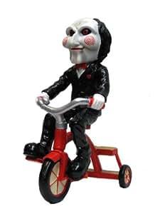 Saw Jigsaw títere en el triciclo