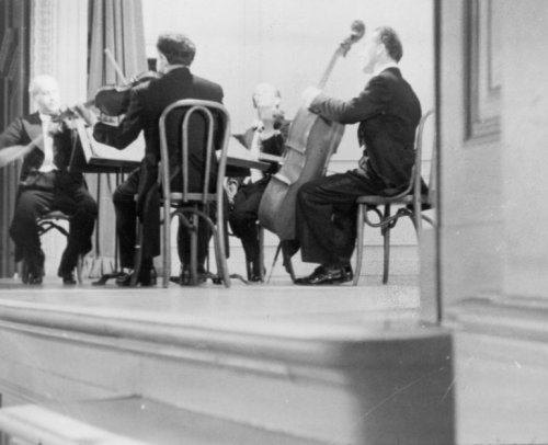 (1945 photo Four members of a string quartet, performing in the Coolidge Audit)